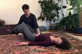 Practitioner gives Breema bodywork at the Breema Clinic in Oakland CA