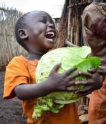 smiling boy with cabbage