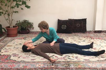 Practitioner shares Breema bodywork at the Breema Center in Oakland, CA