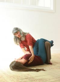 Practitioner giving a Breema bodywork session