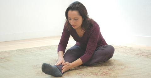 Salena Irion practicing Self-Breema exercises on the floor