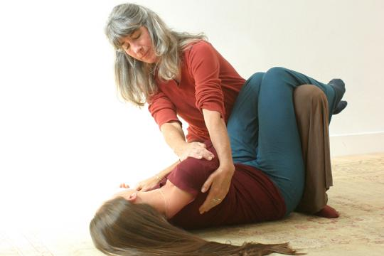 Mary Cuneo practices Breema bodywork with a student